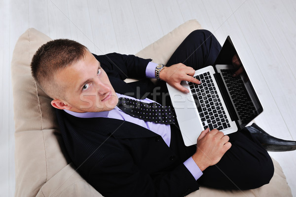 Top view of businessman sitting in comfortable armchair holding laptop Stock photo © zurijeta