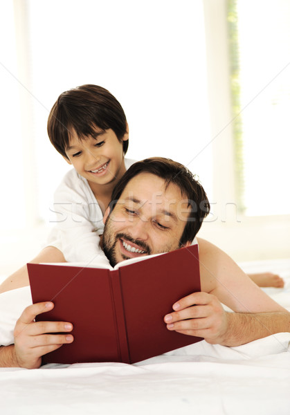 Father and son in bed, happy time Stock photo © zurijeta