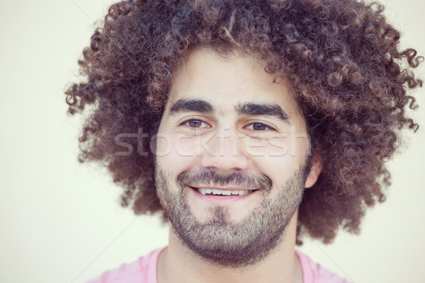 Portrait of young attractive guy with long curly hair Stock photo © zurijeta