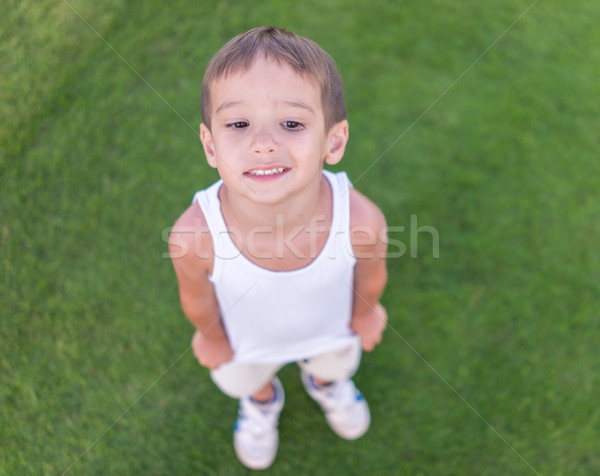 Kid on green grass Stock photo © zurijeta