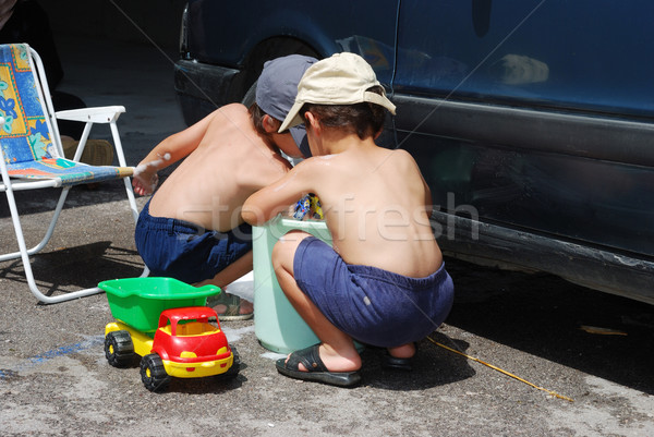 Playing around the car and cleaning, children in summertime Stock photo © zurijeta