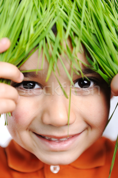 Cute happy kid with grass hair Stock photo © zurijeta