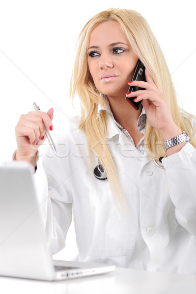 Portrait of a doctor doing her work  with laptop and mobile phone Stock photo © zurijeta