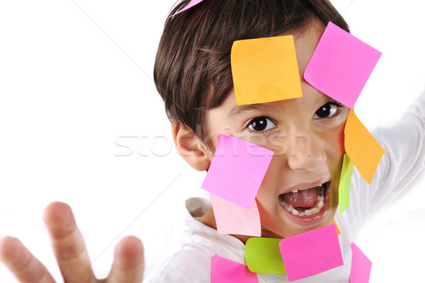 Little boy in panic with memo posts on his face Stock photo © zurijeta