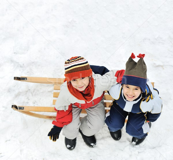 Happy two little boys sitting on sledge Stock photo © zurijeta