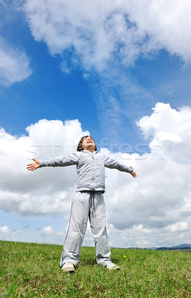 Kid on fresh air in nature with sky and clouds background Stock photo © zurijeta