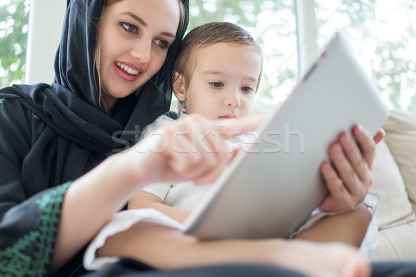 Happy Arabic family having fun time, mom and baby using gadget Stock photo © zurijeta