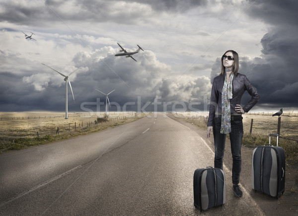 Young woman with baggage waiting for the airplane taxy Stock photo © zurijeta