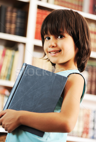 Kid with book in library Stock photo © zurijeta