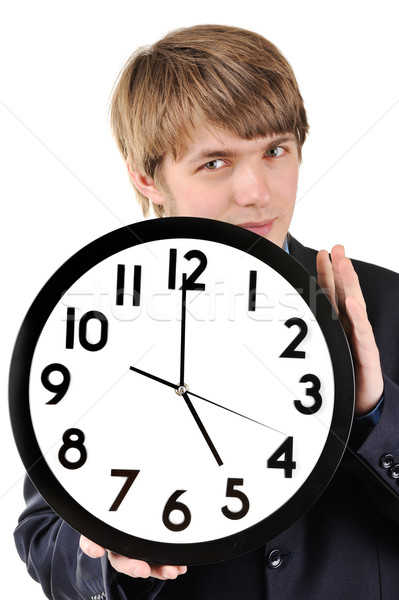 Handsome teenage guy holding clock in his hands Stock photo © zurijeta