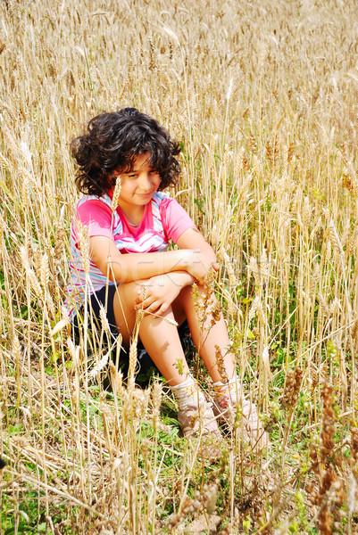 A little pretty girl siting on wheat field Stock photo © zurijeta