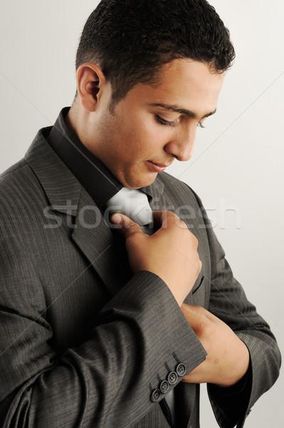 Profile photo of a businessman adjusting his tie Stock photo © zurijeta