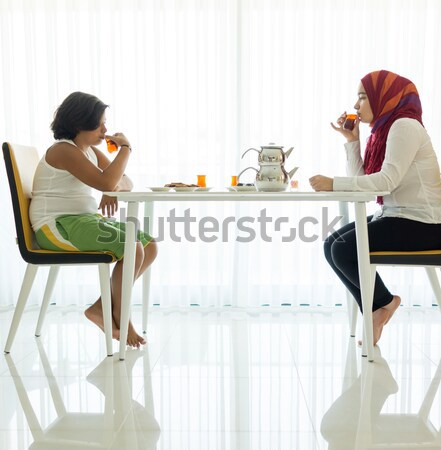 Modern furniture in home, white leather chair, family in background Stock photo © zurijeta