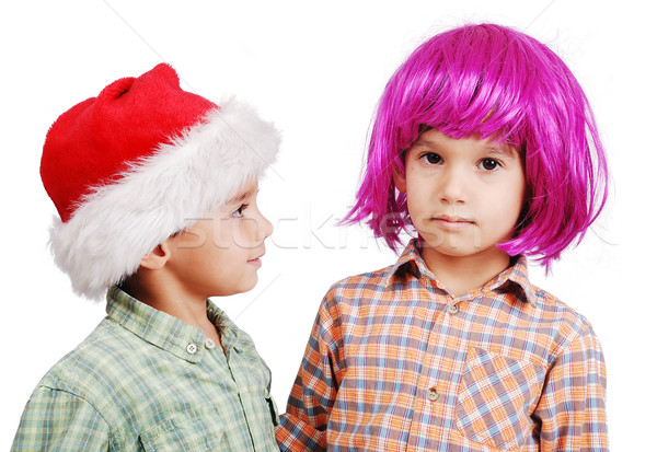 Funny cute boy with pink periwig on head and santa boy Stock photo © zurijeta