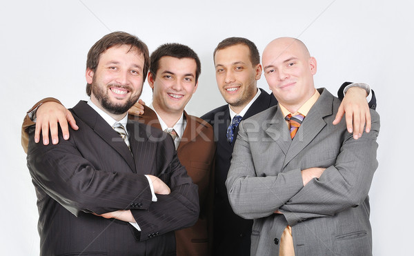 Group of young businessmen together on light background Stock photo © zurijeta