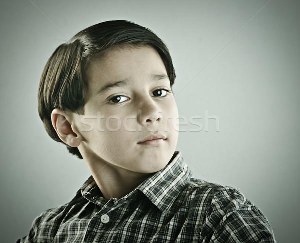 Kicsi aranyos fiú pózol retró stílus fotózás Stock fotó © zurijeta