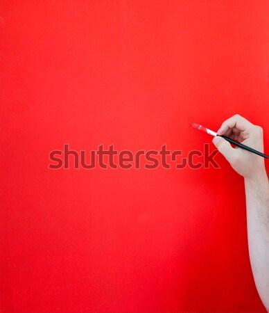 Hand painting red wall Stock photo © zurijeta