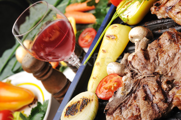 Barbecue, prepared beef meat and different vegetables and mushrooms on grill Stock photo © zurijeta