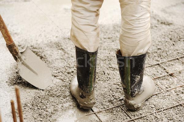 Man leveling concrete slab, working place Stock photo © zurijeta