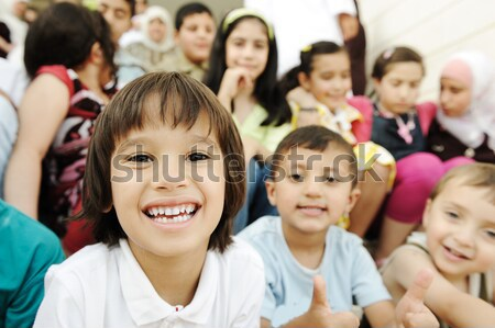 Crowd of children, sitting together happily outdoors in nature Stock photo © zurijeta