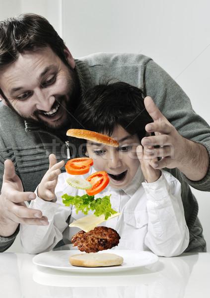 Retro photo of dad and son making hamburger Stock photo © zurijeta
