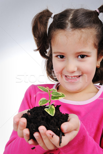 Girl with plant Stock photo © zurijeta