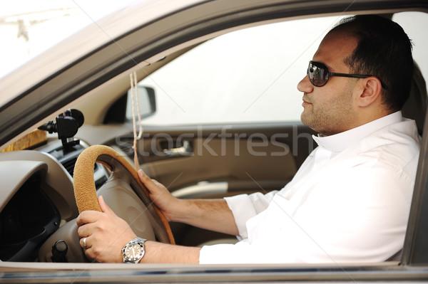Arabic man driving a car Stock photo © zurijeta