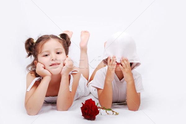 Beautiful scene of a girl and boy laying on ground Stock photo © zurijeta