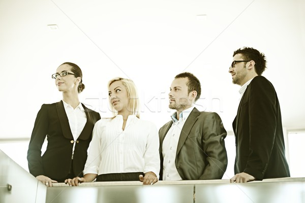Fiiltered successful business people in real office situations Stock photo © zurijeta