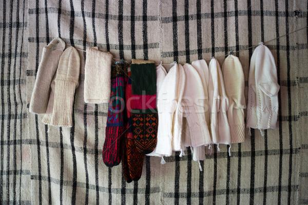 Handcrafted woolen socks on old background Stock photo © zurijeta