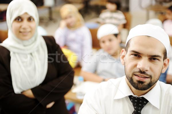Muslim male and female teachers in classroom with childrens Stock photo © zurijeta
