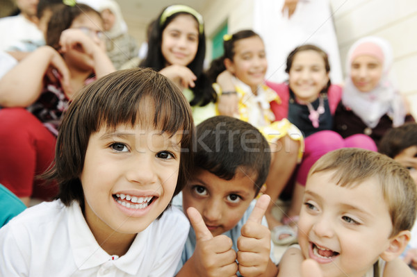 Large group, crowd, lot of happy children of different ages, summer outdoor sitting Stock photo © zurijeta