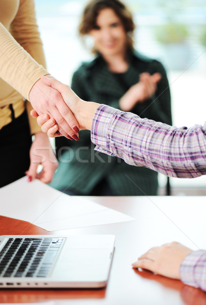 Closing a successful deal with a handshake. Signed contract and applause in the background. Stock photo © zurijeta