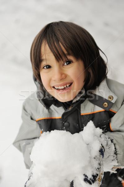 Cute piccolo kid palla di neve felice Foto d'archivio © zurijeta