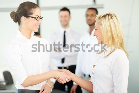 Two business women handshaking after the female deal is done Stock photo © zurijeta