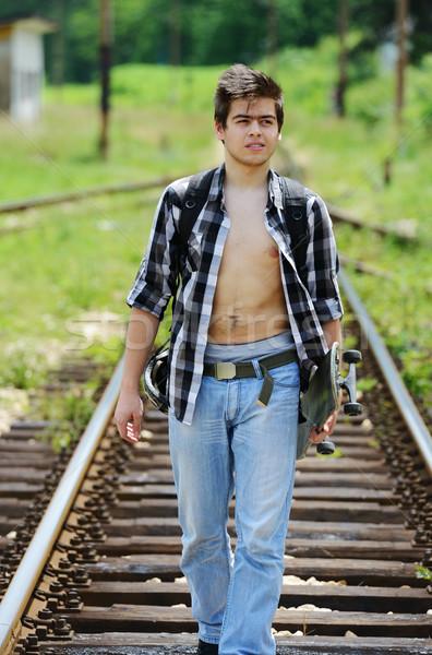 Young man on railroad Stock photo © zurijeta
