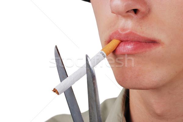Male cutting off cigarette in his mouth Stock photo © zurijeta