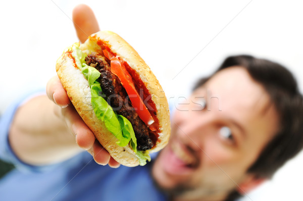 Hamburger fast food man glimlachend voedsel Stockfoto © zurijeta