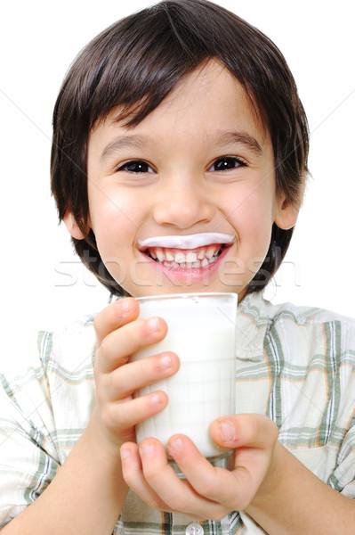 Kid lait yaourt main sourire visage Photo stock © zurijeta