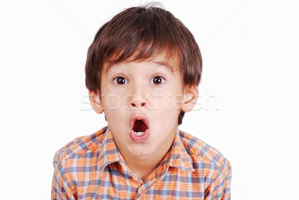 Aranyos vicces fiú meglepődött arc izolált Stock fotó © zurijeta