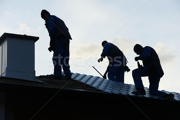 Building roof construction site teamwork Stock photo © zurijeta