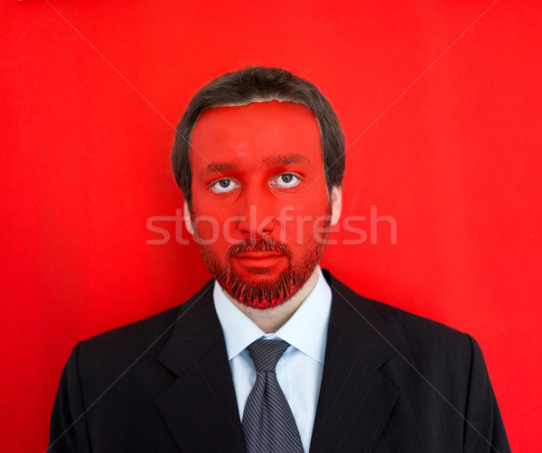 Portrait of adult businessman with colorful red face Stock photo © zurijeta