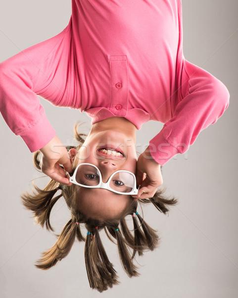 Pequeno menino enforcamento de cabeça para baixo cara feliz Foto stock © zurijeta