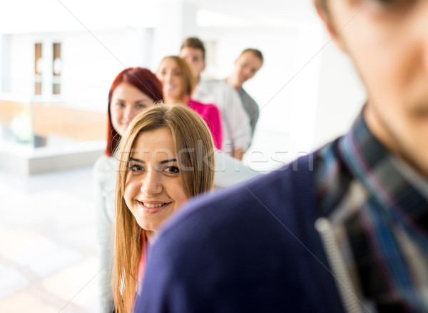 Cheerful students standing in hallway high school Stock photo © zurijeta