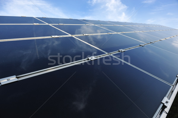 Alternative energy photovoltaic solar panels against blue sky Stock photo © zurijeta