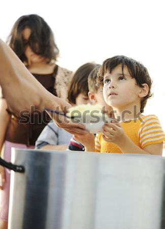 Hungry children in refugee camp, distribution of humanitarian food Stock photo © zurijeta