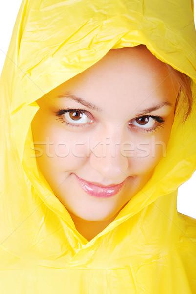 Beautiful girl with yellow hood Stock photo © zurijeta