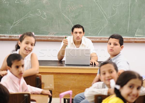 Children at school classroom Stock photo © zurijeta