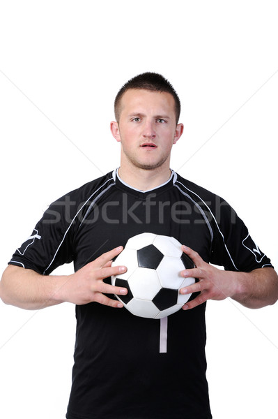 Soccer player holding a football isolated on white background Stock photo © zurijeta
