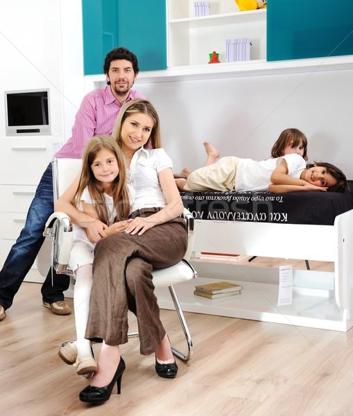 Stok fotoğraf: Mutlu · genç · aile · birlikte · ev · poz